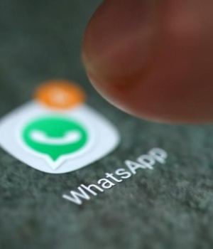 The WhatsApp app logo is seen on a smartphone in this illustration