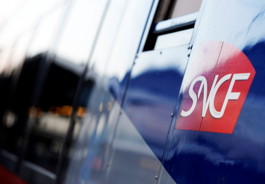 The logo of SNCF is pictured on a train arriving at the French state-owned railway company SNCF station in Bordeaux