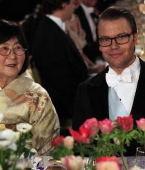 Mrs. Sumire Negishi, wife of Nobel Prize laureate for Chemistry Ei-ichi Negishi of Japan and Westling of Sweden attend the Nobel banquet at Stockholm's City Hall