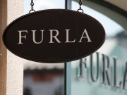 A board with Furla store logo is seen on a shopping center at the outlet village Belaya Dacha outside Moscow