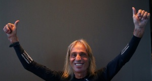 """French climber Alain Robert, also known as """"The French Spiderman"""", gestures during an interview in Barcelona"""