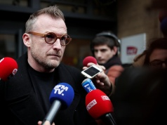 Eric Meyer, representative of the SUD Rail union, arrives to attend an inter-union meeting of the French state-owned railway company SNCF to decide on a possible strike movement, in Paris