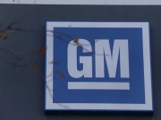 The GM logo is seen at the General Motors Lansing Grand River Assembly Plant in Lansing,