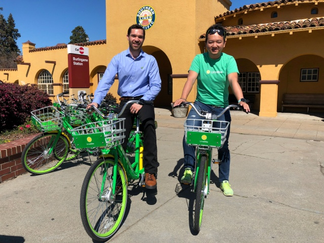 Co-founders Toby Sun and Caen Contee of California-based bike sharing startup LimeBike show off their bikes at a recently-launched pilot program in Burlingame