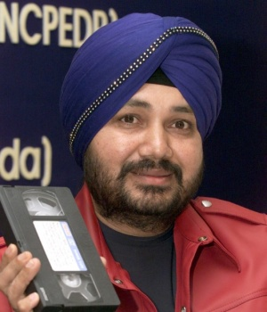 INDIAN SINGER DALER MEHNDI HOLDS A VIDEOCASSETTE IN NEW DELHI.