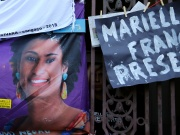 A mourner reacts next to a picture of the Rio de Janeiro city councillor Marielle Franco, 38, who was shot dead, during a demonstration ahead of the wake outside the city council chamber in Rio de Janeiro