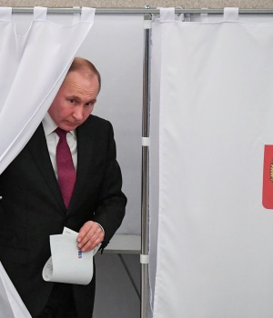Russian President and Presidential candidate Vladimir Putin at a polling station during the presidential election in Moscow