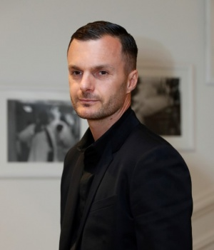 Kris Van Assche poses before attending the the Dior Haute Couture Fall Winter 2016/2017 fashion show in Paris
