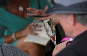Racegoers drink champagne at the Ascot racecourse at Ascot near London