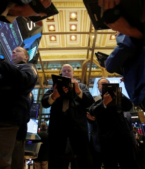 Traders work on the trading floor at the New York Stock Exchange (NYSE) in Manhattan, New York