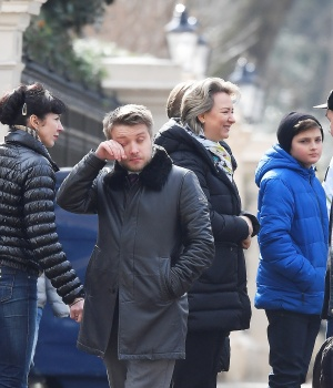 Embassy staff react as colleagues and children board buses outside Russia's Embassy in London