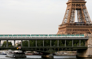 An elevated Paris Metro passes over a bridge next to the Eiffel Tower in Paris