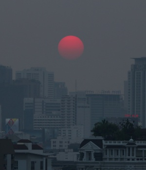 The sun is seen through evening air pollution in Bangkok
