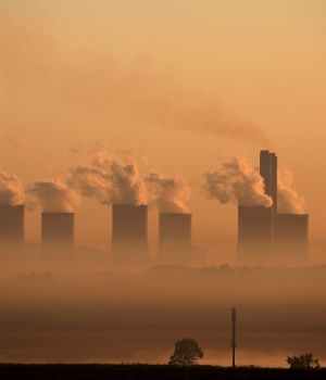 Steam rises at sunrise from the Lethabo Power Station, a coal-fired power station owned by state power utility ESKOM near Sasolburg
