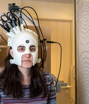 A woman is seen wearing a lightweight and highly sensitive brain imaging device in this undated handout photograph supplied by Wellcome