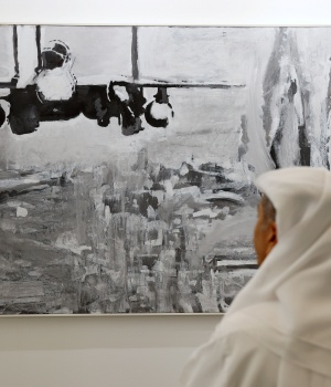 A visitor looks at artworks made by a Palestinian artist at the annual Art Dubai exhibition in Dubai
