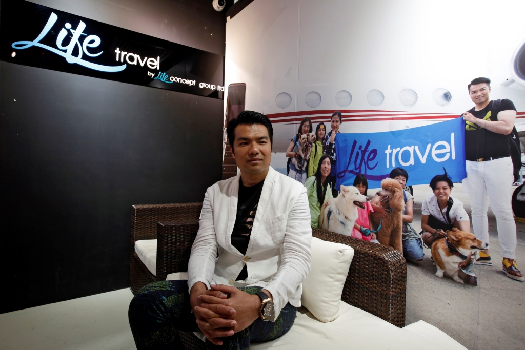 Life Travel Business Development Director Raymond Chung poses in his office in Hong Kong