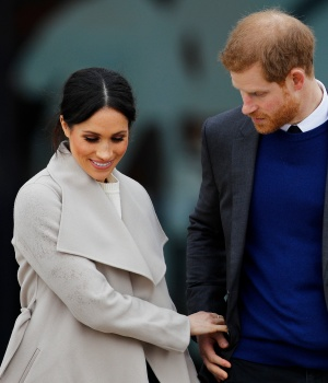 Britain's Prince Harry, and his fiancee Meghan Markle, leave after a visit to the Titanic tourist attraction in Belfast