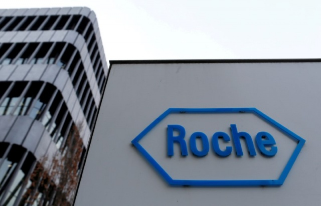 The logo of Swiss pharmaceutical company Roche is seen outside their headquarters in Basel, Switzerland.