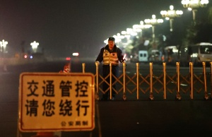 Policemen take position along Beijing's main east-west thoroughfare, Changan Avenue, near the Great Hall of the People in Beijing