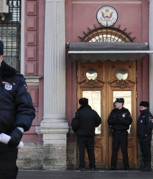 Policemen stand guard outside the building of the consulate-general of the U.S. in St. Petersburg