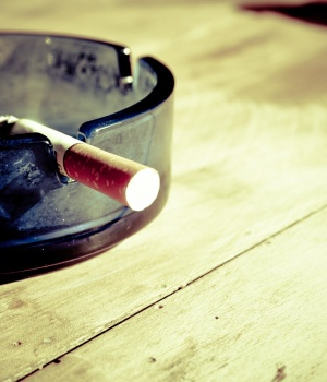 Employee health plans charge smokers extra but don't help them quit
