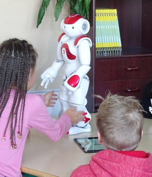 Students use a language trainer robot Ellias during their lesson at the school in Tampere