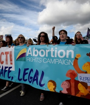 Demonstrators hold posters as they march for more liberal Irish abortion laws in Dublin