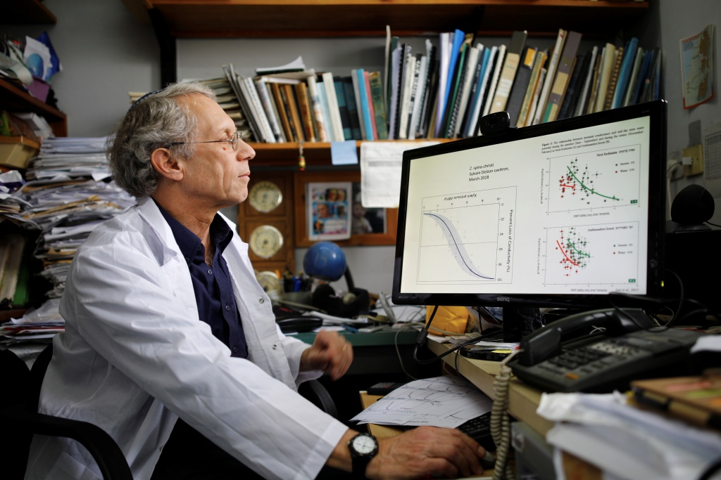 Dr. Shabtai Cohen looks at his computer during an interview, in his office at the Volcani Agricultural Research Centre in Beit Dagan, Israel