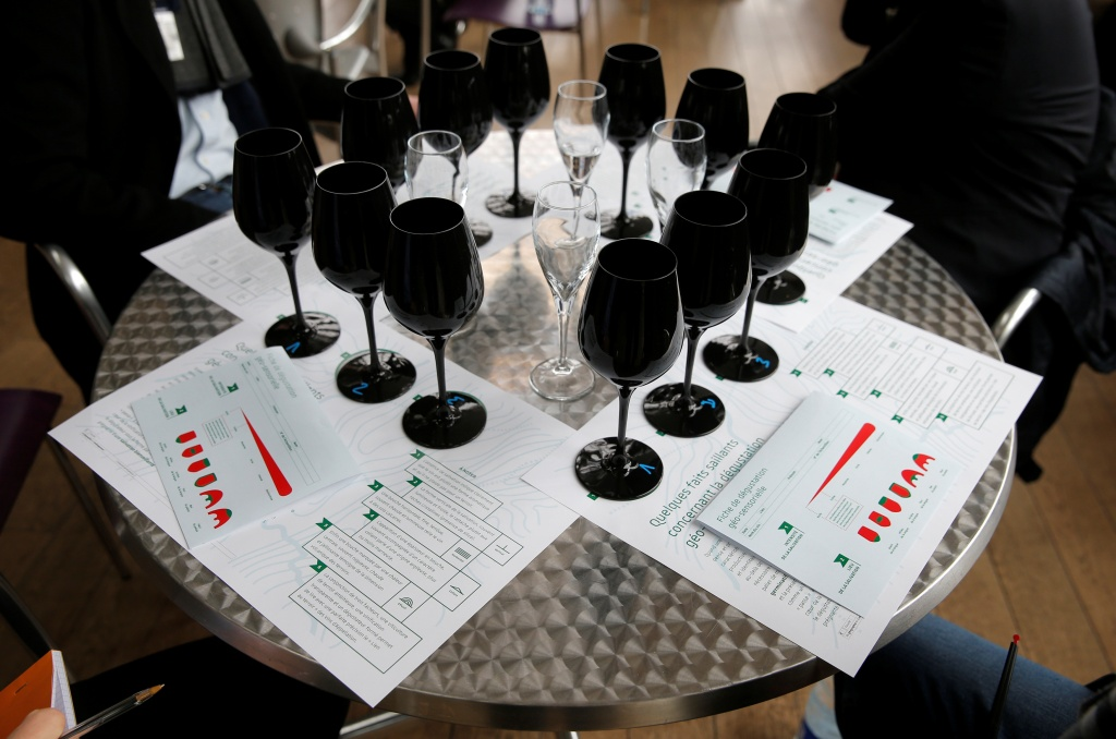 Black glasses specially designed for wine blind testing are disposed on a table during the presentation of the new Strasbourg University geo-sensorial wine tasting university degree