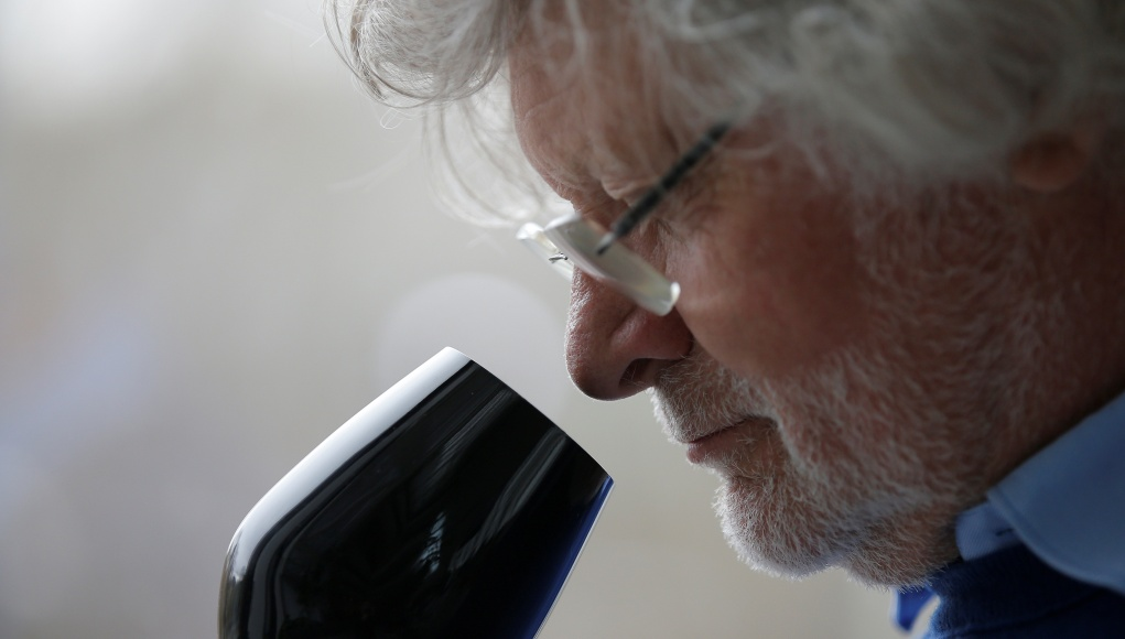 Deiss, French winemaker and president of the university of great wines, smells wine in a black glass, specially designed for wine blind testing, during the presentation of the new Strasbourg University geo-sensorial wine tasting university degree