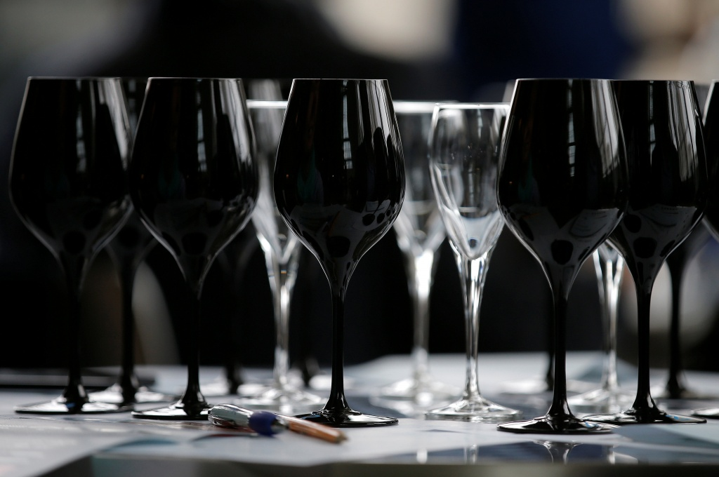 Black glasses specially designed for wine blind testing are seen on a table during the presentation of the new Strasbourg University geo-sensorial wine tasting university degree