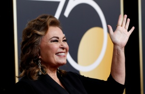 Actress Roseanne Barr reacts as she arrives at the 75th Golden Globe Awards in Beverly Hills