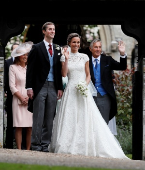 Pippa Middleton and James Matthews pose for photographs after their wedding at St Mark's Church in Englefield