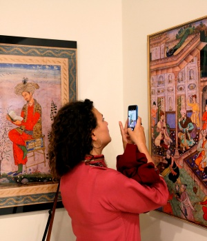 Woman takes photo at art exhibition at Babur Garden in Kabul