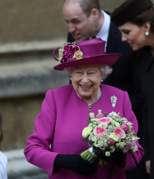 Britain's Queen Elizabeth and Prince William and Catherine, Duchess of Cambridge, leave the annual Easter Sunday service at St George's Chapel at Windsor Castle in Windsor