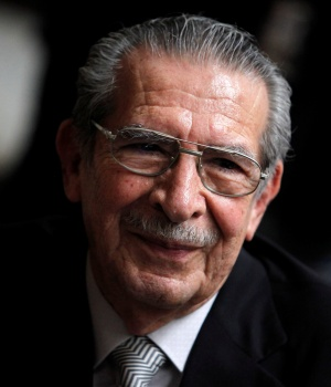 Former Guatemalan dictator Rios Montt smiles during his genocide trial, which is drawing to a conclusion, at Supreme Court of Justice in Guatemala City