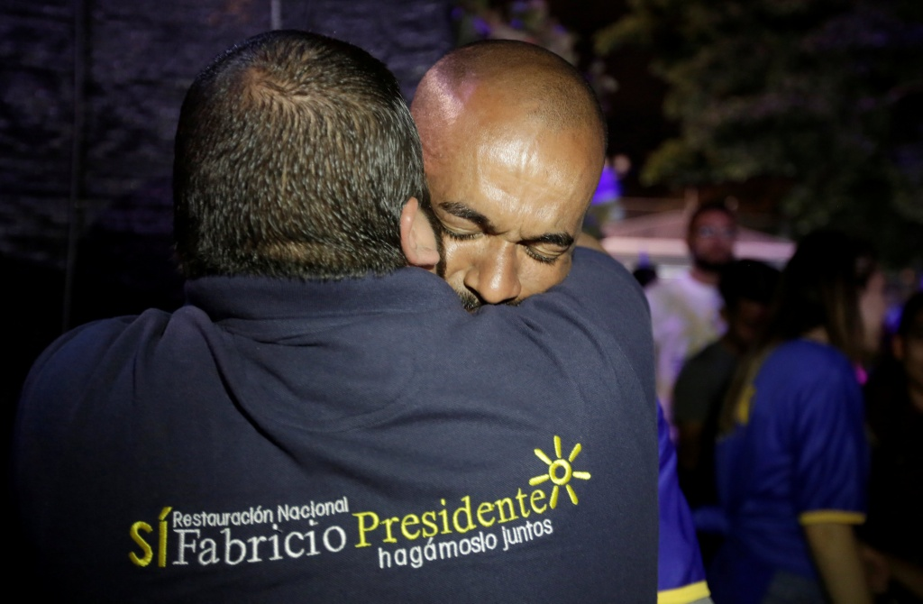 Supporters of Fabricio Alvarado Munoz, presidential candidate of the National Restoration party (PRN), react after the first official presidential election results were released, in San Jose, Costa Rica