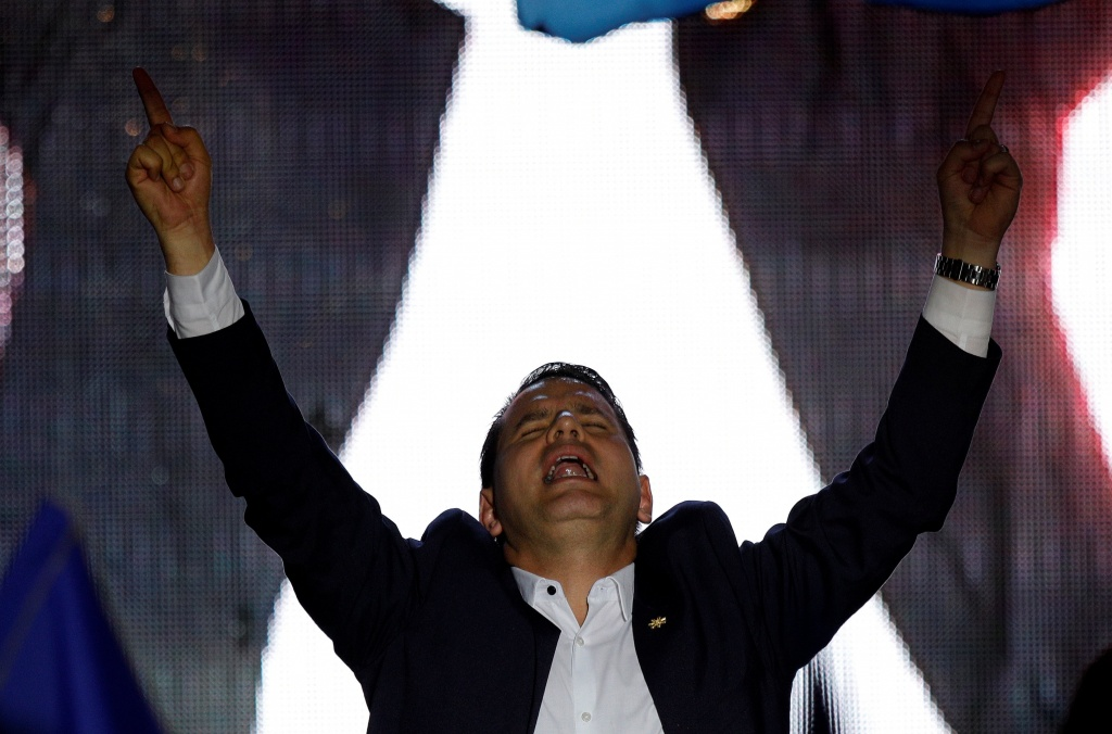 Fabricio Alvarado Munoz, presidential candidate of the National Restoration party (PRN), gestures during a rally after the official election results were released in San Jose