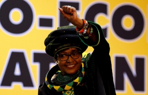 Winnie Madikizela Mandela, ex-wife of former South African president Nelson Mandela, gestures to supporters at the 54th National Conference of the ruling African National Congress (ANC) at the Nasrec Expo Centre in Johannesburg