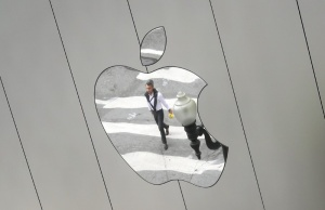 A man is reflected in a Apple store logo in San Francisco
