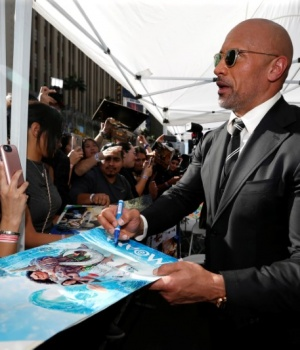 Actor Johnson signs autographs after unveiling his star on the Hollywood Walk of Fame in Los Angeles