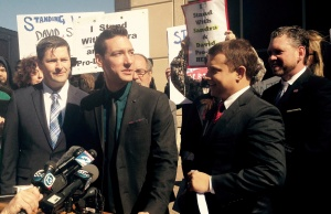 Anti-abortion activist Daleiden speaks at a news conference outside court in Houston