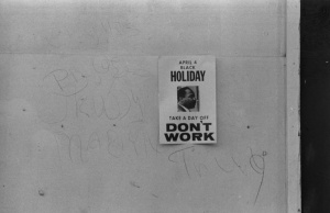 """A """"Don't work"""" sign promoting a holiday to honor the anniversary of the assassination of Martin Luther King, Jr., on a shop on H Street, N.W., Washington, D.C."""