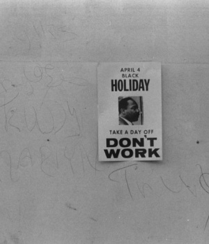 "A ""Don't work"" sign promoting a holiday to honor the anniversary of the assassination of Martin Luther King, Jr., on a shop on H Street, N.W., Washington, D.C."