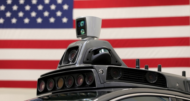 A roof mounted camera and radar system is shown on Uber's Ford Fusion self driving car during a demonstration of self-driving automotive technology in Pittsburgh