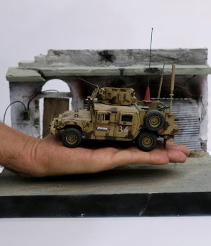 Mini-diorama, showing Iraqi Army vehicle, is seen at home of its creator Radwan Nasser Abdel Amir, a former Iraqi soldier in Kerbala