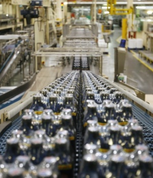 Bottles soft drinks made by drinks company Britvic sit on a conveyor belt at Britvic's bottling plant in London