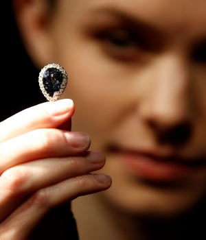 A model poses with 'The Farnese Blue' diamond at Sotheby's auction house in London