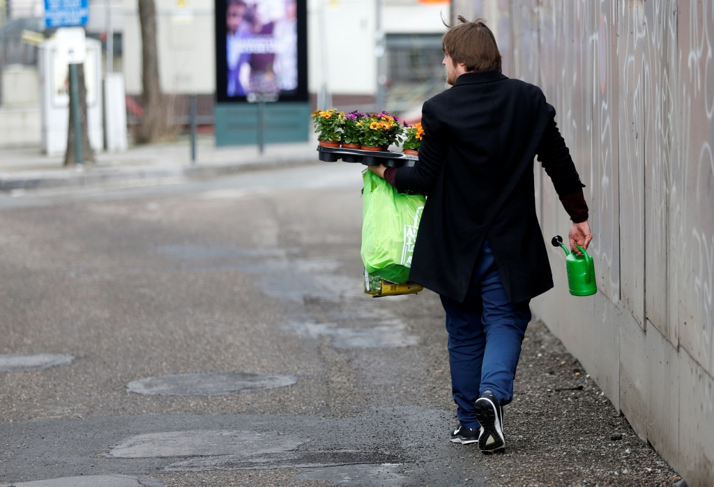 Brussels resident Anton Schuurmans looks for unrepaired potholes to plant flowers in Brussels